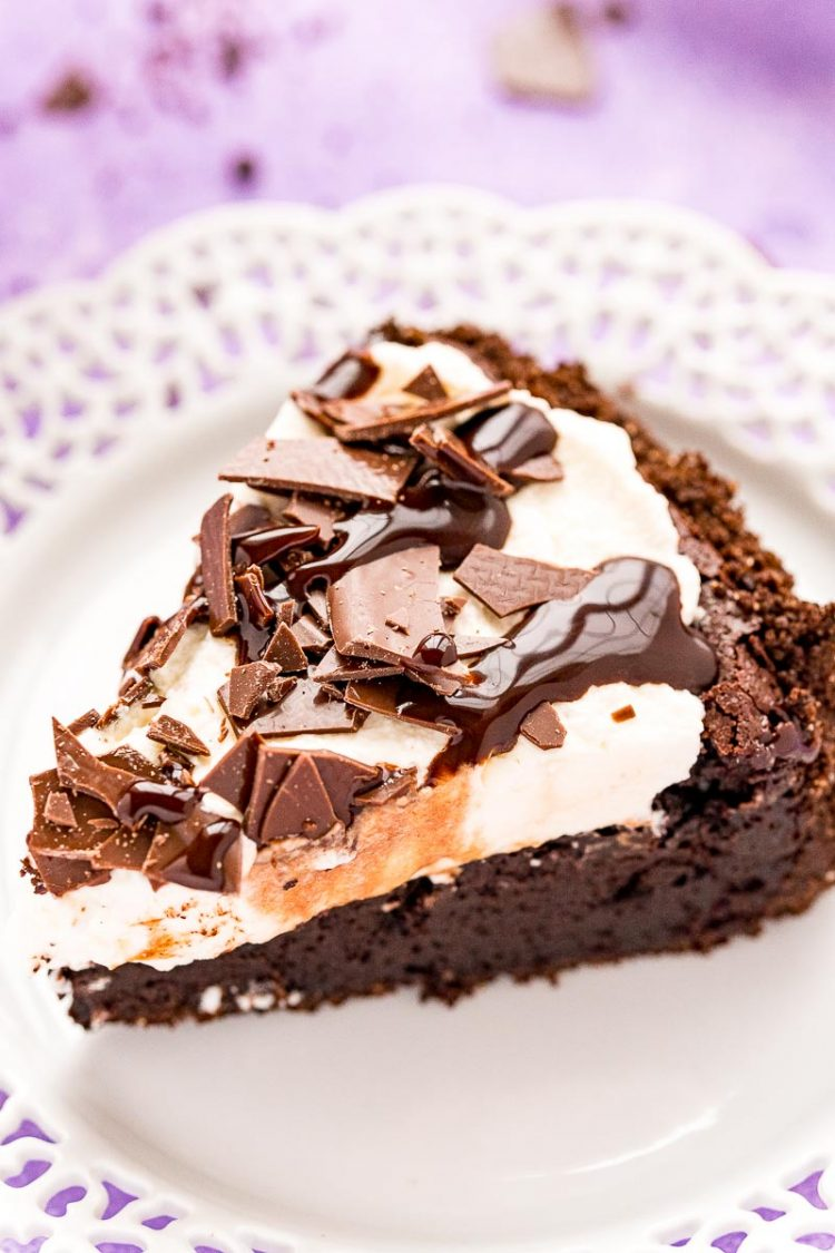 Close up photo of a slice of Mississippi Mud Pie on a white plate.