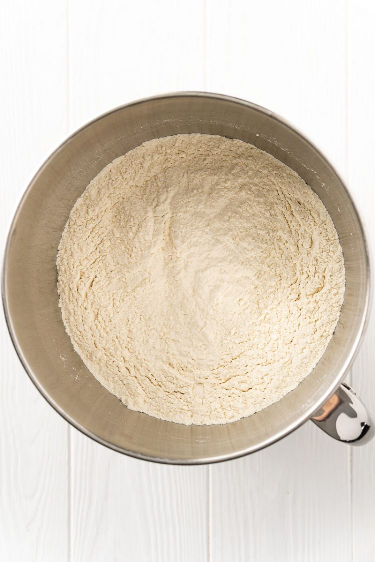 Dry ingredients to make bread in a stand mixer bowl.