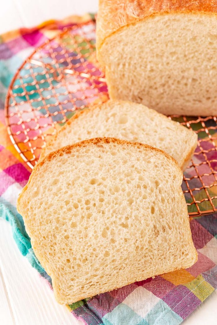 Slices of white bread on a colorful napkin.