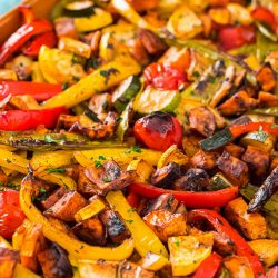Roasted vegetables on a sheet pan.