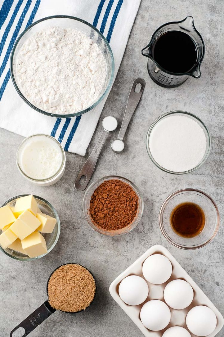 Overhead photo of ingredients to make Chocolate Buttermilk Cake on a grey table.