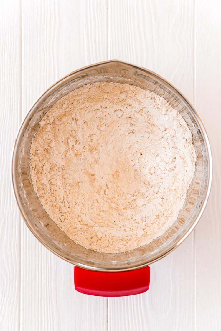 Dry ingredients to make cookies mixed together in a stainless steel mixing bowl.