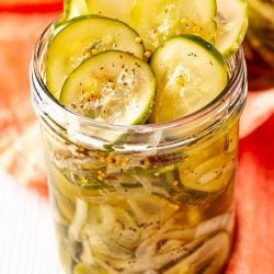 Bread and butter pickles in a mason jar.