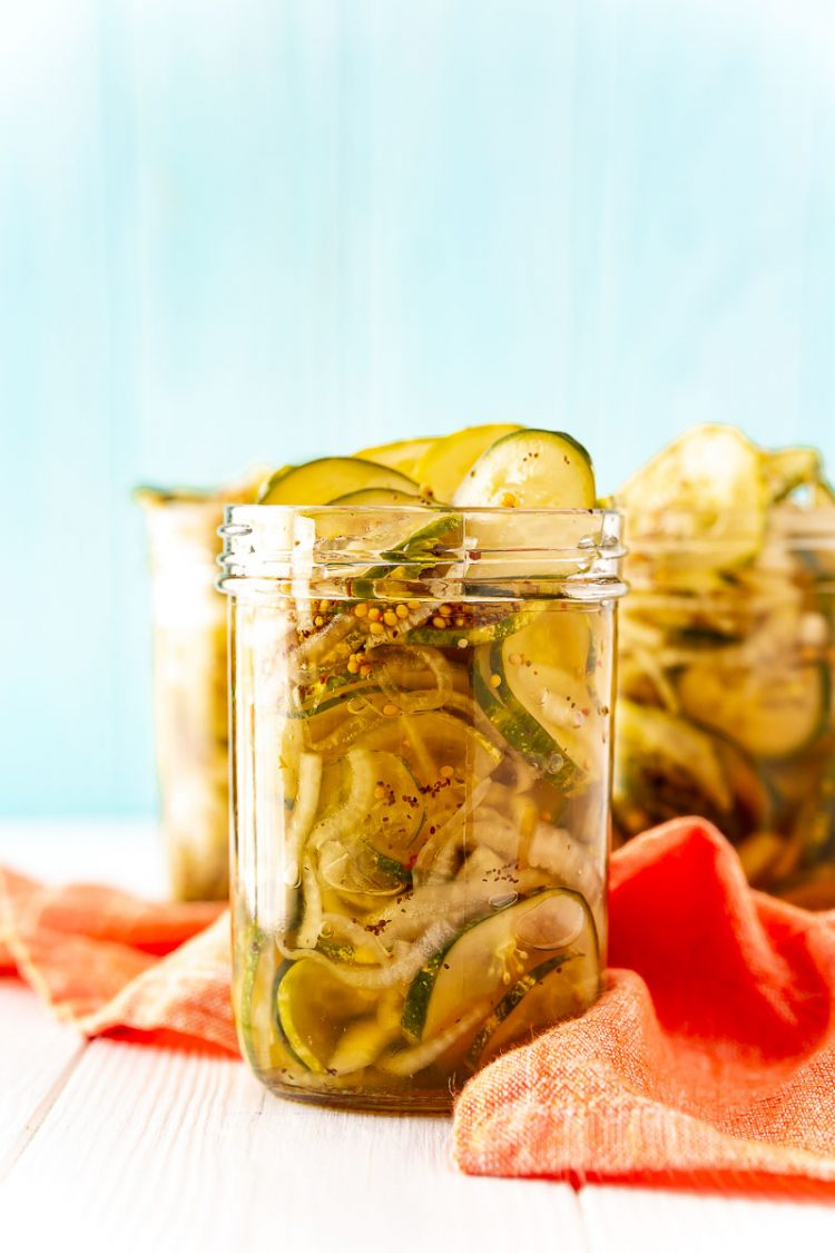 Bread and butter pickles in a pint mason jar.