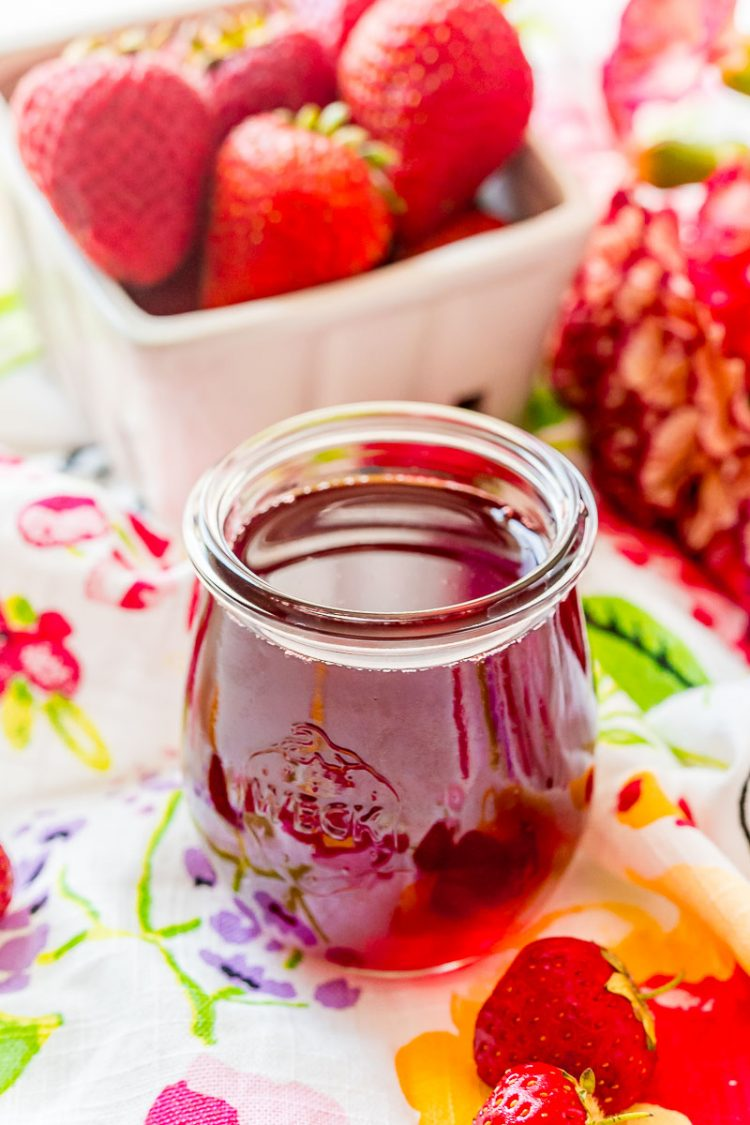 strawberry simple syrup in a small weck jar.