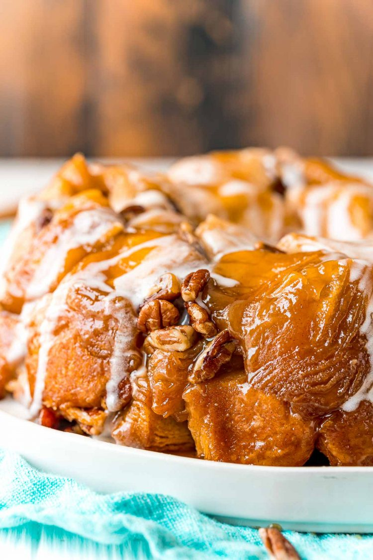 Close up photo of monkey bread on a white plate.