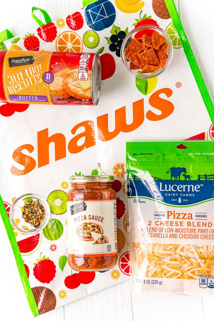 Ingredients to make mini pizzas on a shaws reusable bag.