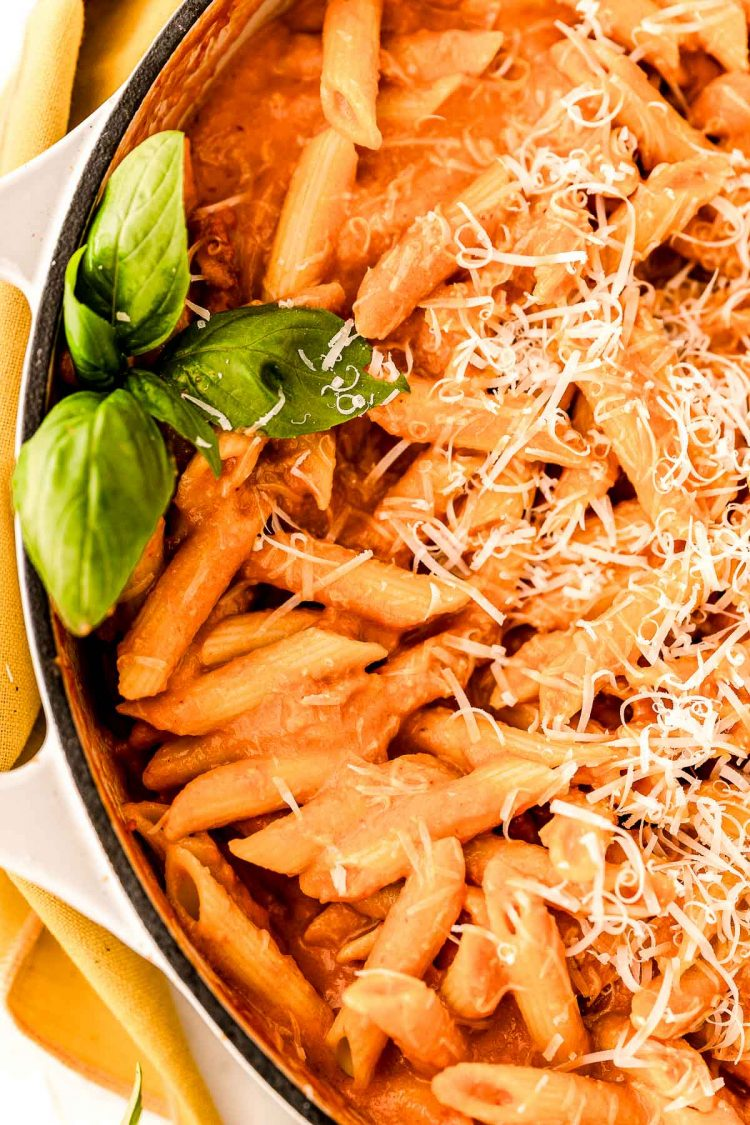 Close up photo of penne with vodka sauce in a large skillet.