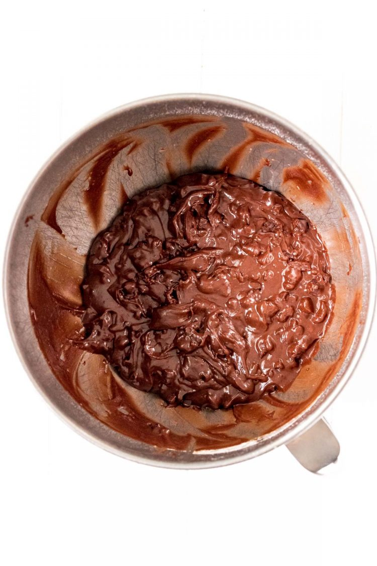Brownie cookie dough in a metal mixing bowl.