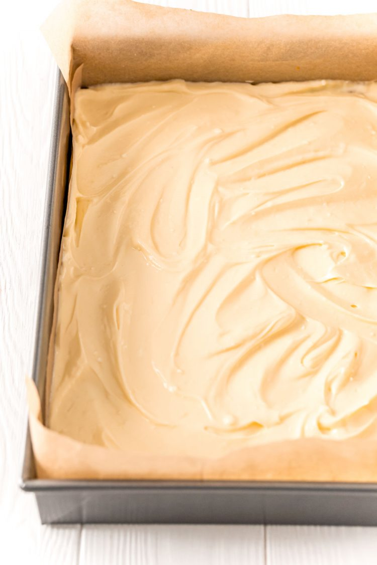 Chesecake batter in a 9x13-inch baking pan.