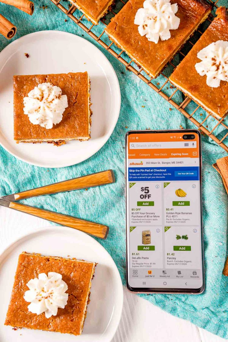 Overhead photo of the Shaw's app open on a phone surrounded by pumpkin pie bars.