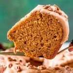 Slice of pumpkin pound cake on a serving spatula being lifted away from the cake.