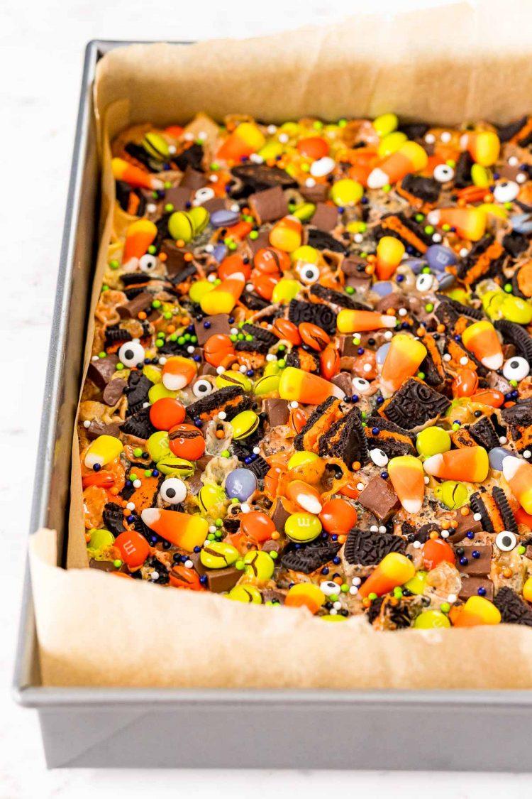 Halloween Magic 7 layer bars in a baking pan.