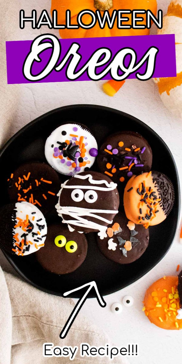 Halloween Chocolate Covered Oreos combine candy with everyone's favorite cookie! Oreos are dipped in melted chocolate and covered in Halloween sprinkles, candy eyeballs, and chocolate swirls.  via @sugarandsoulco