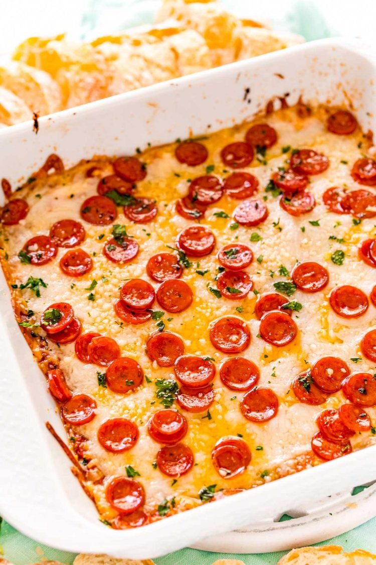 Pizza dip in a white square baking dish.