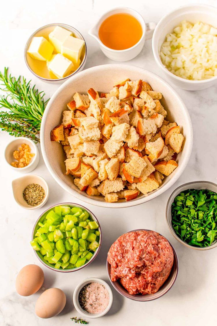 Overhead photo of ingredients to make sausage stuffing on a table.