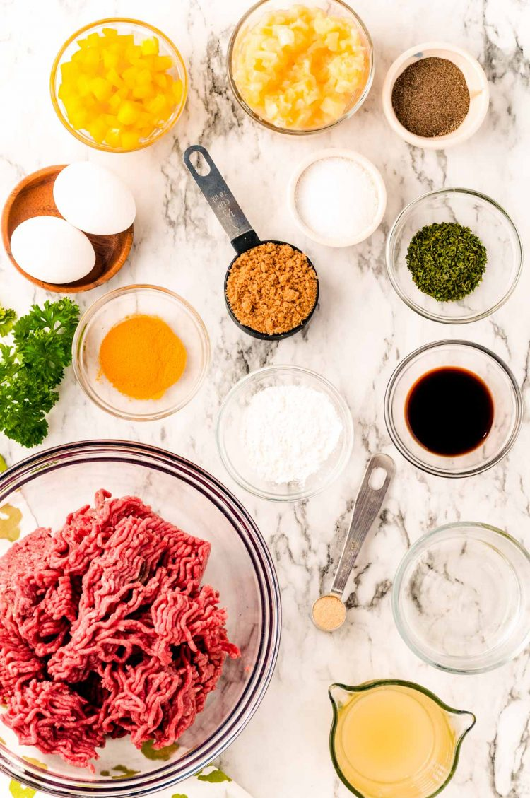 Overhead photo of ingredients prepped on a marble table to make sweet and sour meatballs.