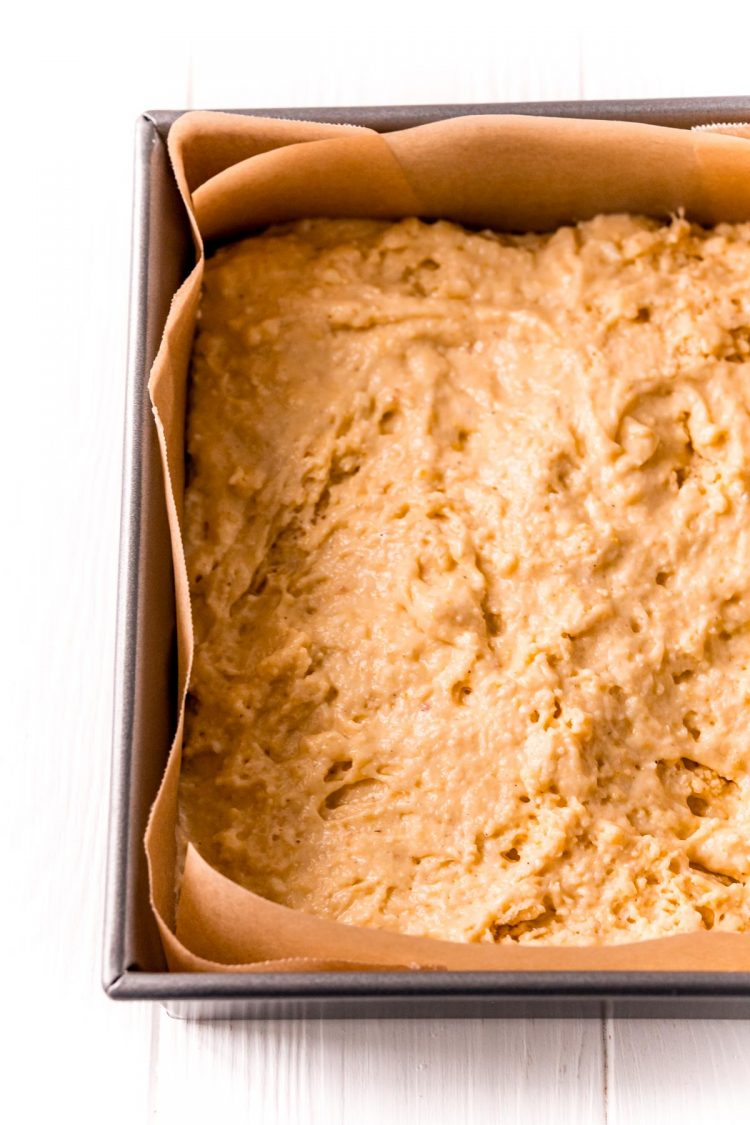 Cornbread batter in a baking pan ready to go in the oven.