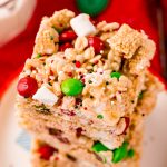 Close up photo of a stack of rice krispie treats with m&ms.