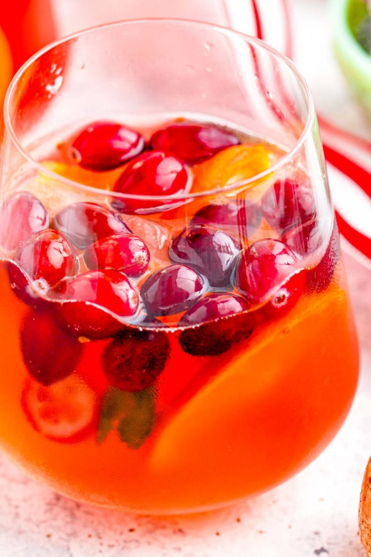 Close up photo of a glass filled with christmas punch.