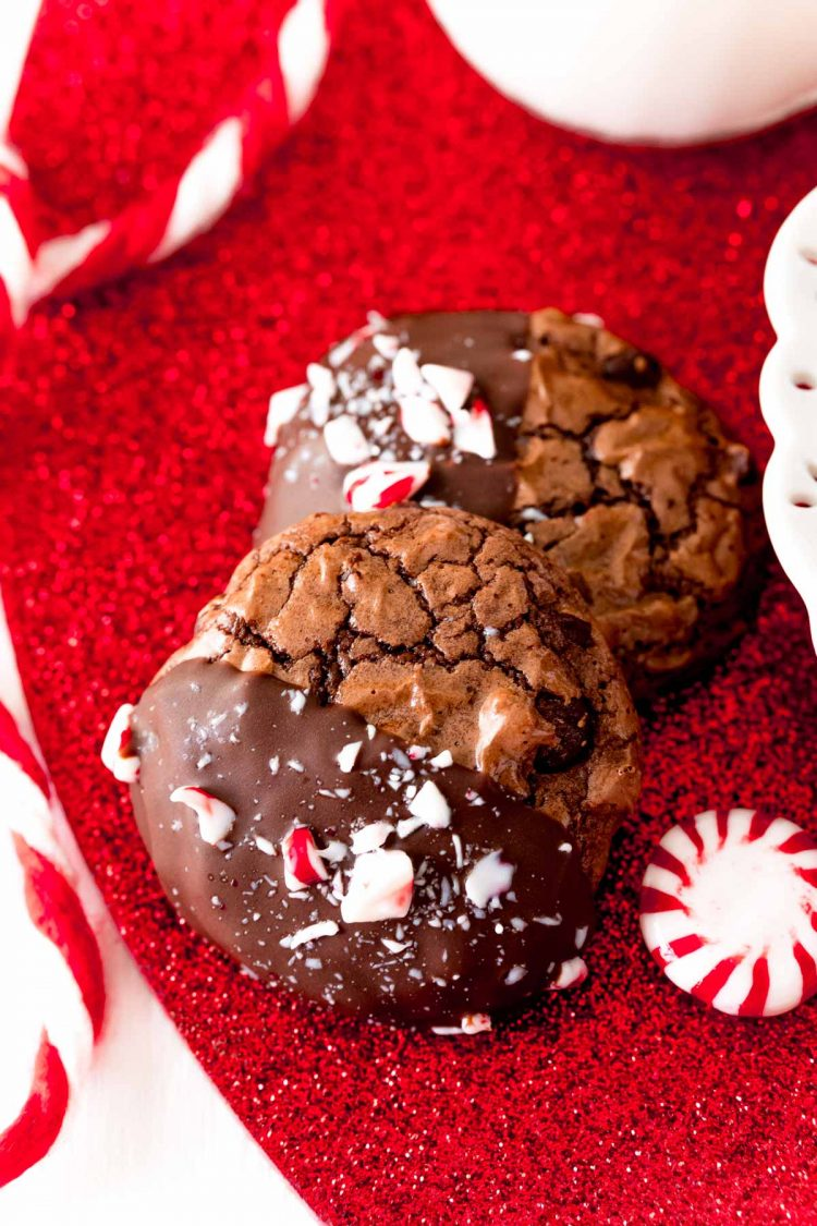 Close up photo of Peppermint brownie cookies on a red glittery surface.