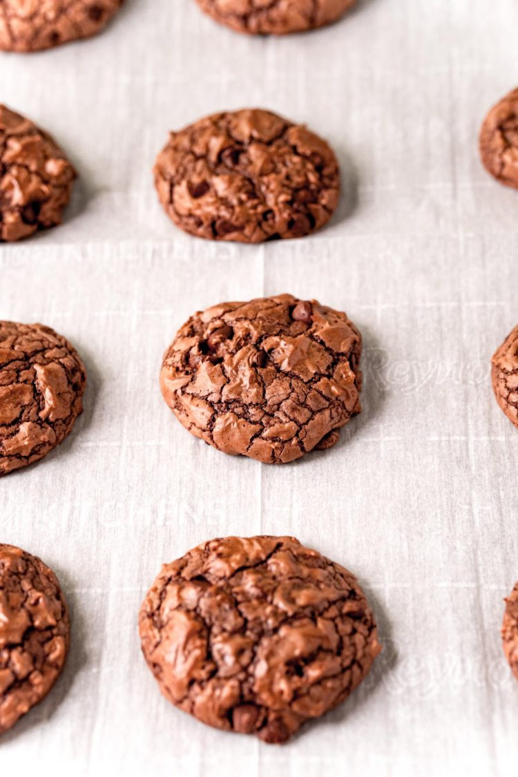 Brownie cookies on a parchment lined baking sheet.