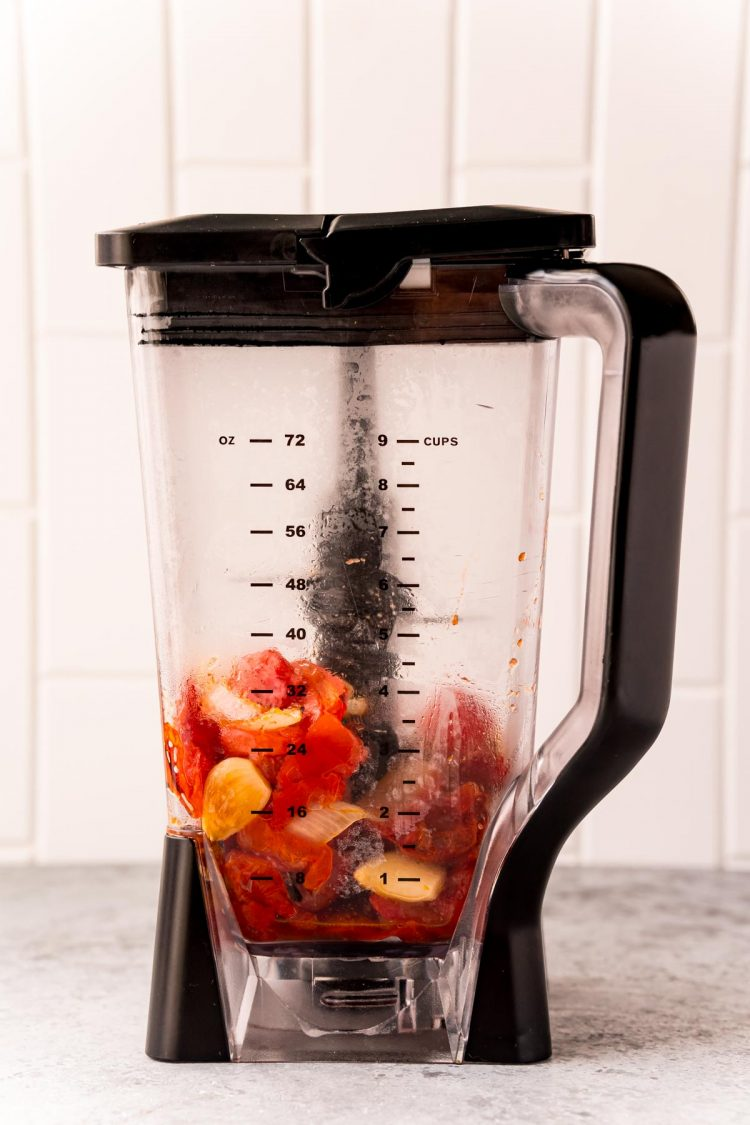 Roasted tomatoes and onions in a blender.