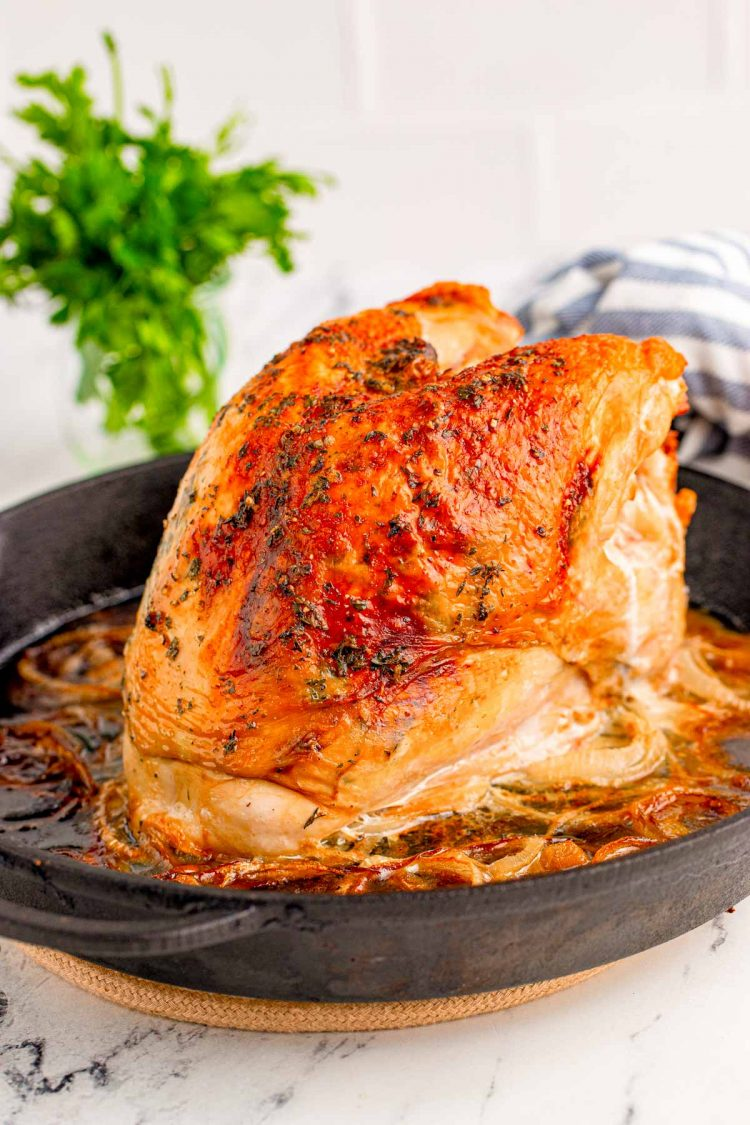 A roasted turkey breast in a castiron skillet.