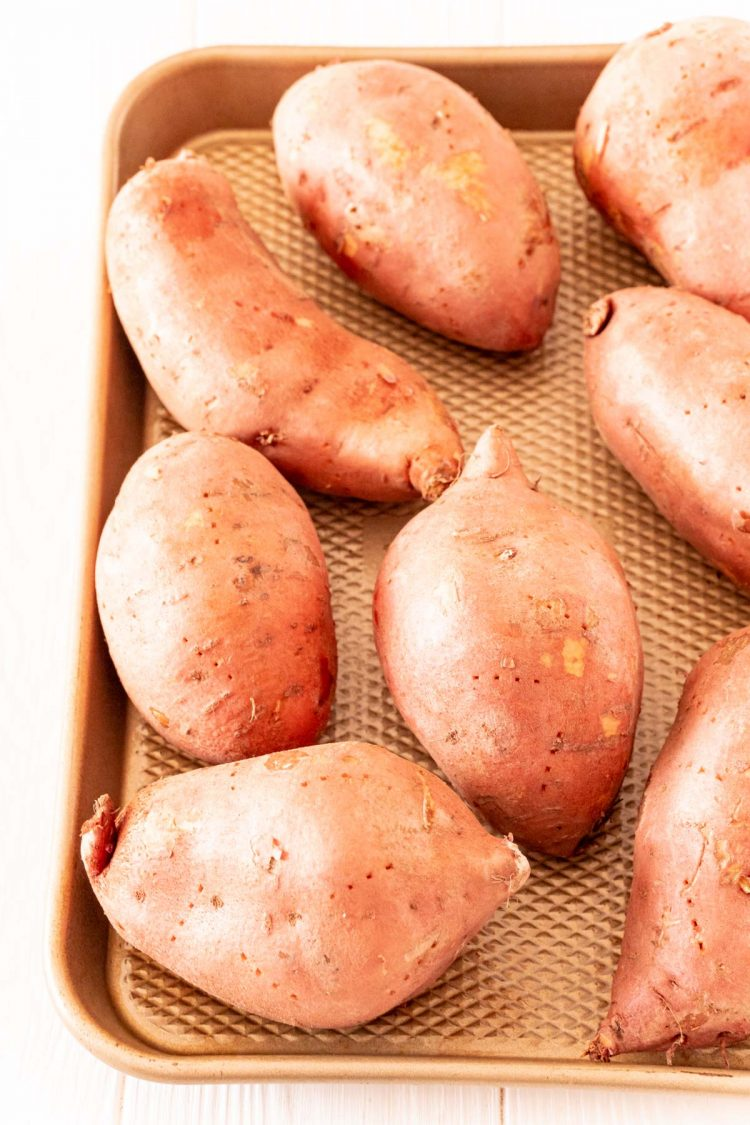Sweet potatoes on a baking sheet.