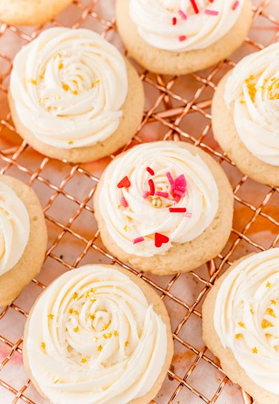 Champagne Sugar Cookies are an amazingly light and fluffy cookie topped with a silky and luxurious champagne buttercream frosting! These cookies are perfect for New Year's Eve, but can also be enjoyed while cuddled up next to the one you love on Valentine's Day or when celebrating the new bride!