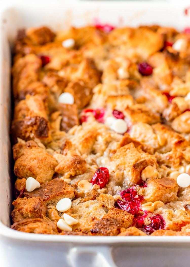 Cranberry and white chocolate bread pudding in a white baking dish.