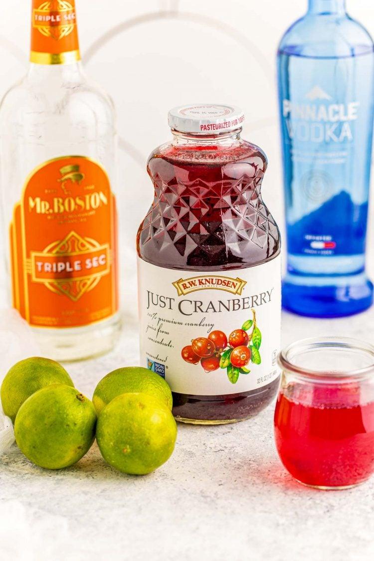Ingredients to make a cranberry cosmopolitan.