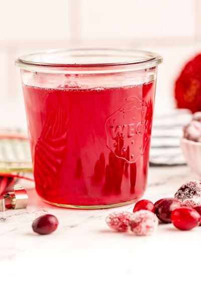 Close up photo of a weck jar filled with cranberry simple syrup.
