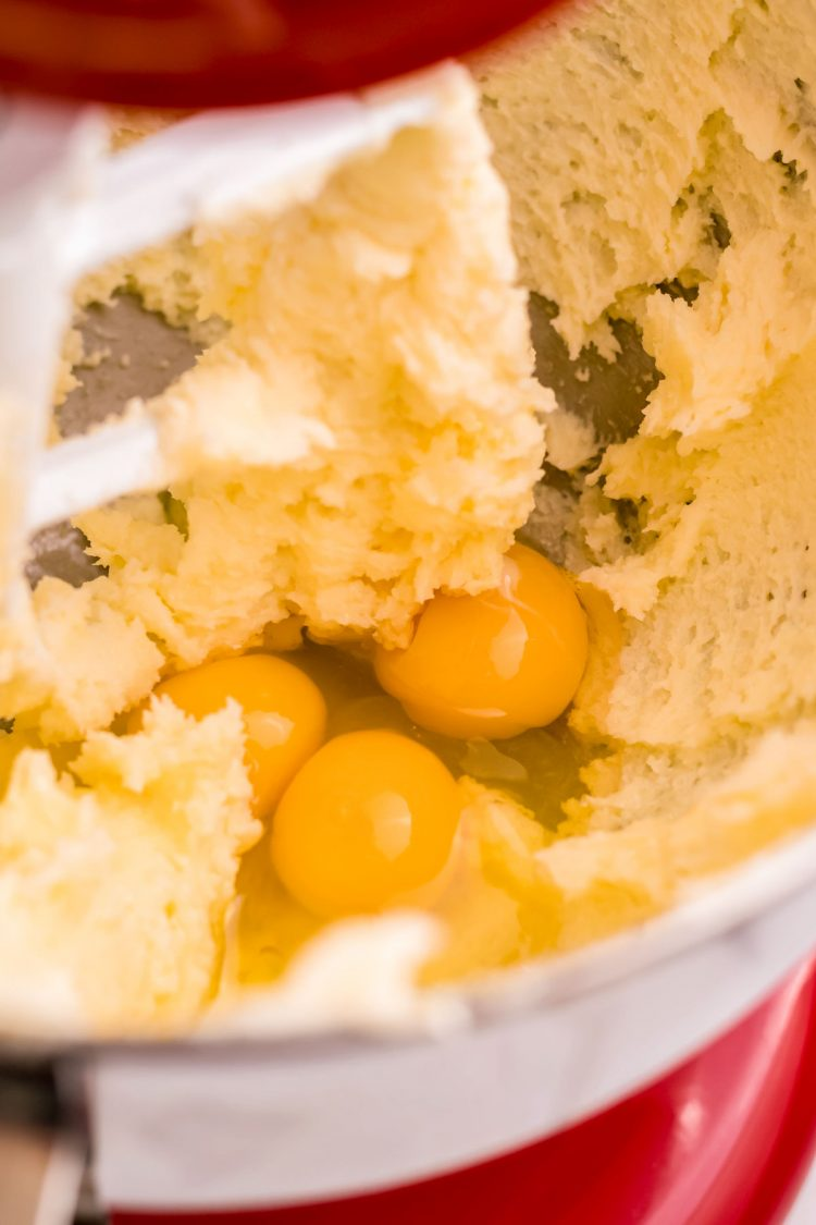 Eggs added to creamed butter and sugar in a stand mixer.