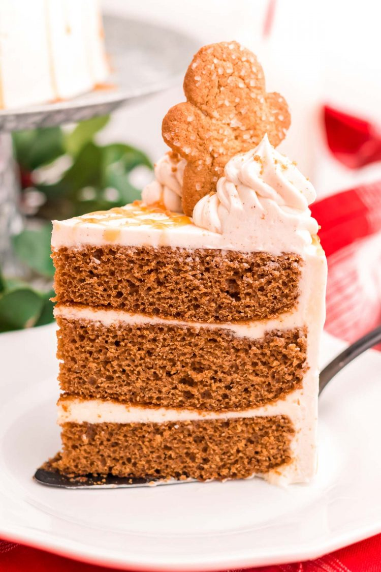 A slice of gingerbread cake on a white plate.