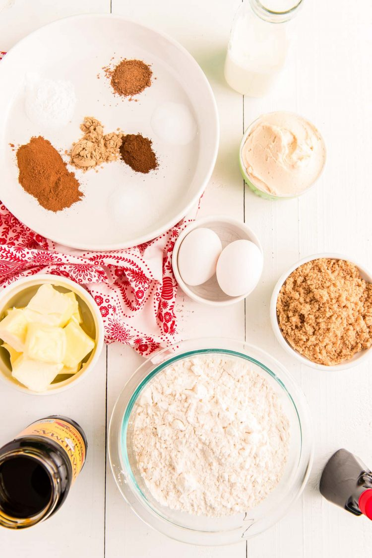 Overhead photo of ingredients to make gingerbread whoopie pies in prep bowls on a white table.