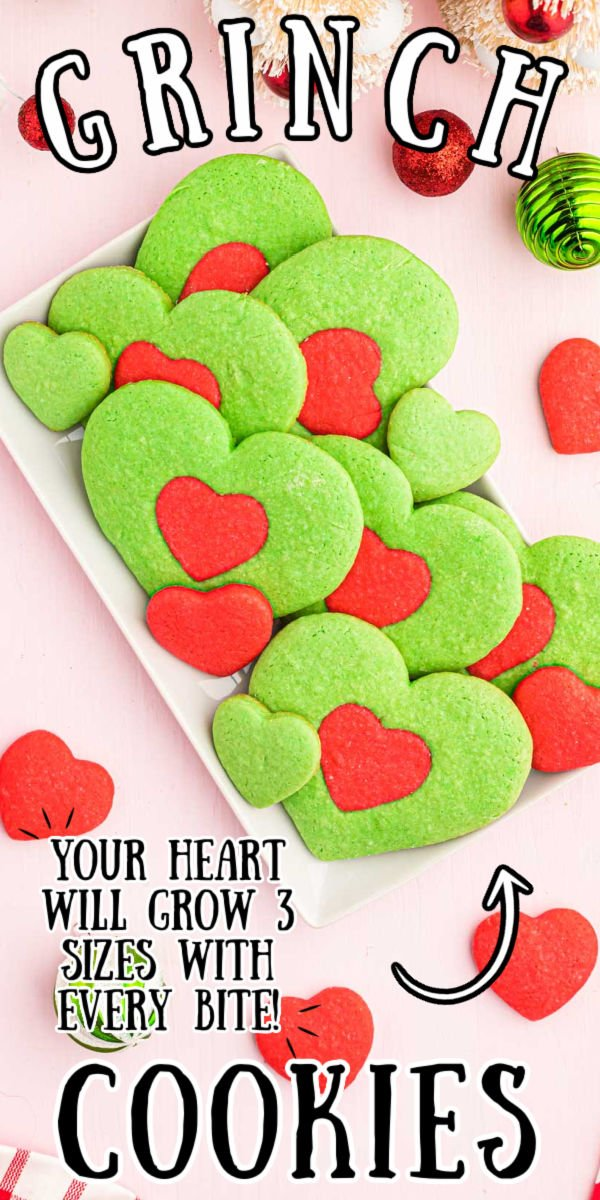 These Heart-Shaped Grinch Cookies were inspired by the most recent adaptation of How The Grinch Stole Christmas! Made with a basic sugar cookie dough and colored red and green to create the cutest cookies of the season! via @sugarandsoulco