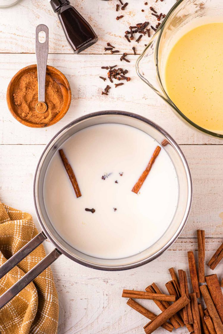 Cream and spices in a saucepan.