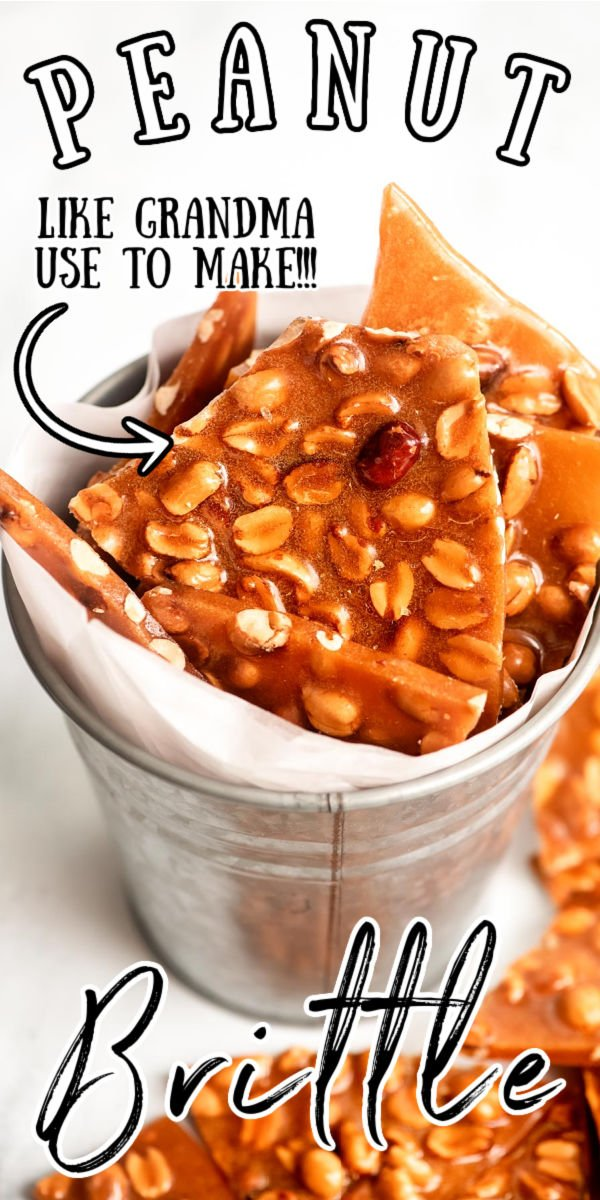 Homemade Peanut Brittle is perfect for making and sharing around the holidays! A crunchy candy layer is loaded with roasted peanuts for a sweet and salty treat. via @sugarandsoulco