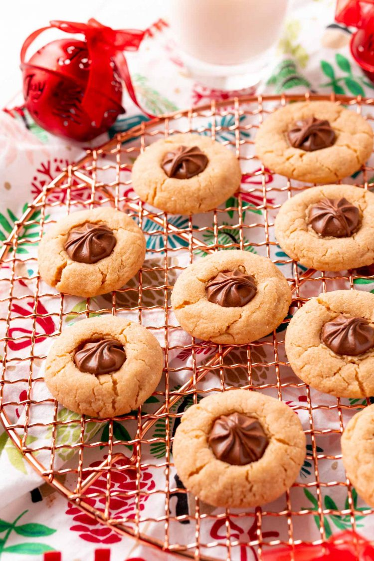 Peanut butter blossoms on a copper wire rack.