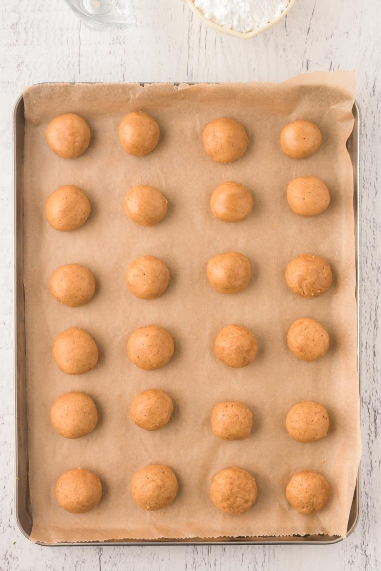 Overhead photo of spice cookies on a parchment lined baking sheet.