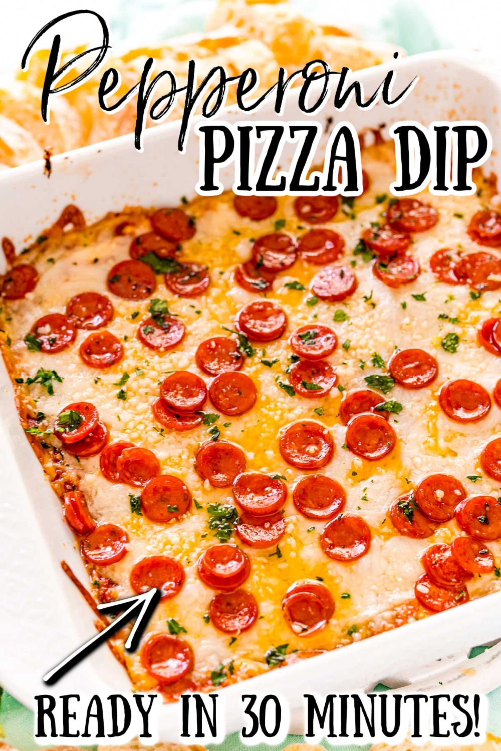 Pizza Dip is a warm cheesy appetizer perfect for game day parties, potlucks, or holidays! Pair this dip with your favorite tortilla chips, crackers, bread, or even vegetables and watch it quickly disappear as it becomes the crowd favorite!  via @sugarandsoulco
