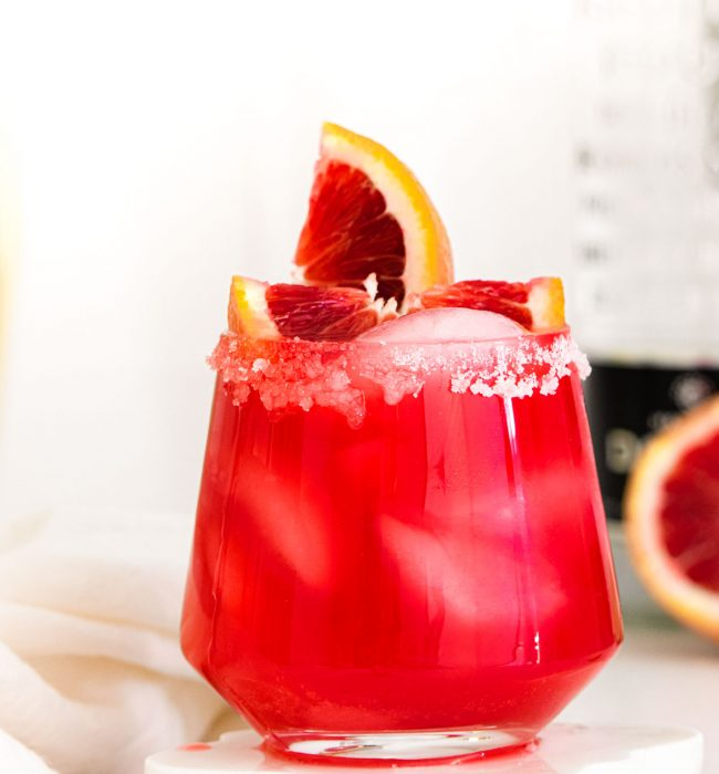 Close up photo of a blood orange margarita.
