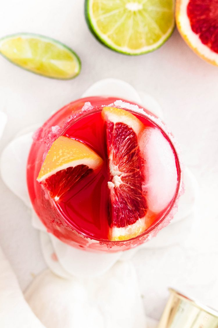 Overhead photo of a red cocktail garnish with blood orange.