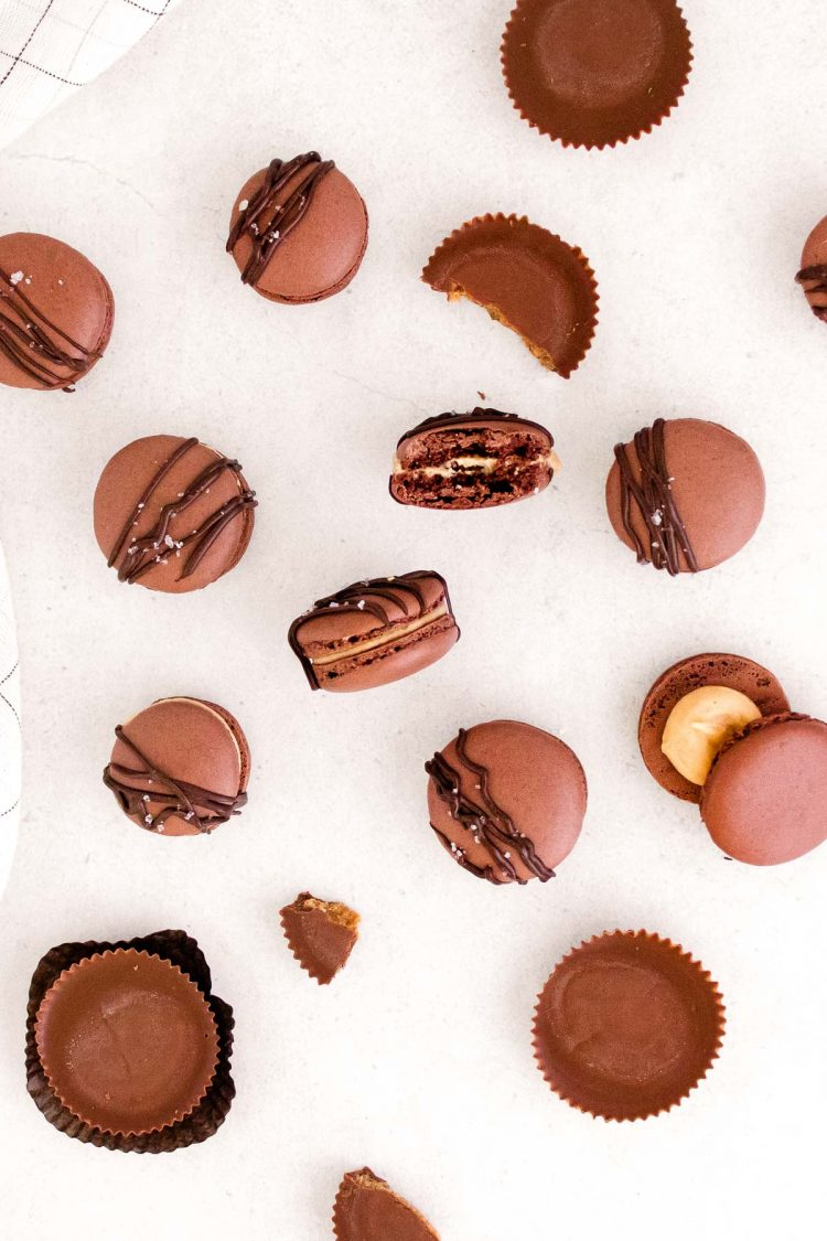 Overhead photo of peanut butter macarons on a white counter.