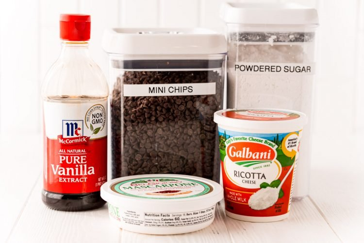 Ingredients used to make cannoli dip on a white table.