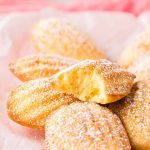 Close up photo of French Madeleines on a pink napkin.