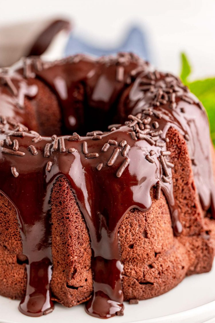 Close up photo of a chocolate bundt cake topped with ganache.