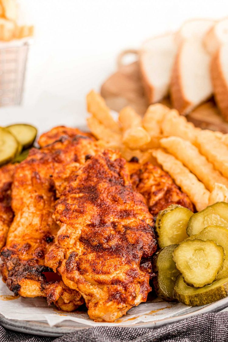 Close up photo of Nashville hot chicken on a plate.