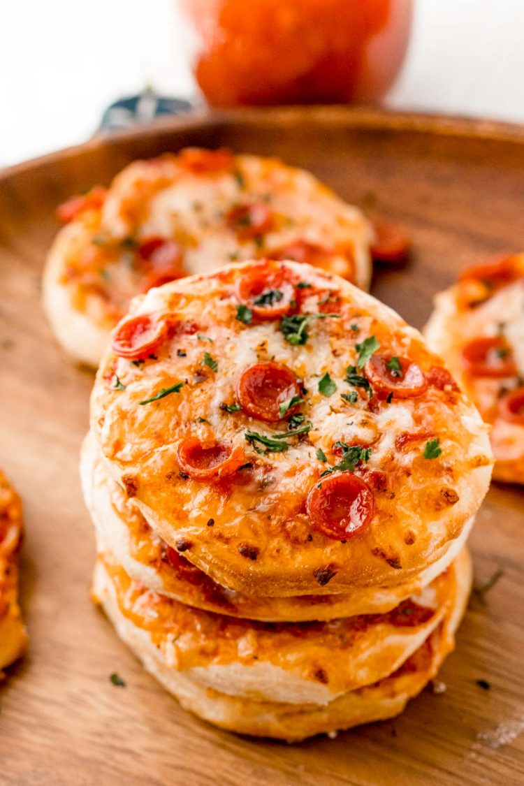 Three mini pizzas stacked on top of each other.